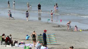 People enjoy the sunshine at Ballygalley beach in Co Antrim on Thursday, May 28 the hottest day of the year.  Pic: Pacemaker Stephen Davison