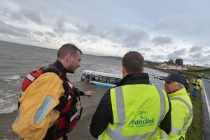 Pacemaker Press Belfast 09-12-2015: Newtownards, County Down: Bus lands on beach following crash. A bus has landed on a beach after crashing on the Portaferry Road near Newtownards, County Down. The driver of the Ulsterbus sustained minor injuries in the incident which happened at about 06:30 AM on Wednesday. Picture By: Arthur Allison.