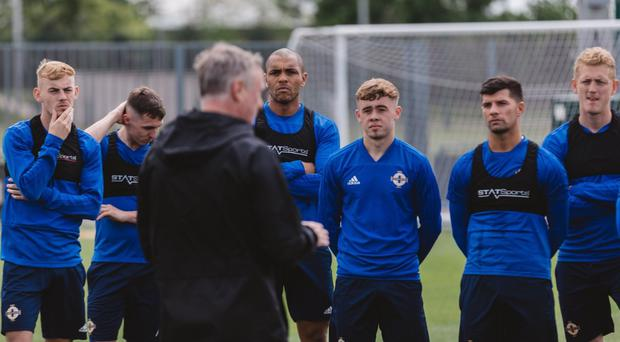 Leeds United teenager Alfie McCalmont (third from right) listens to boss Michael O'Neill at Northern Ireland's training camp in Manchester.