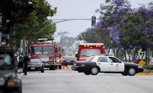 SANTA MONICA, CA - JUNE 07:  An ambulance arrives on scene after multiple shootings were reported on the campus of Santa Monica College June 7, 2013 in Santa Monica, California.  According to reports, at least one person has died, four people hospitalized, and a suspect was taken into custody. (Photo by Kevork Djansezian/Getty Images)