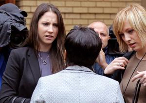 Aimee Pistorius,left, the sister of Oscar Pistorius, speaks with unidentified people as she arrives for his trial at the high court in Pretoria, South Africa, Monday, March 3, 2014. Oscar Pistorius is charged with murder with premeditation in the shooting death of girlfriend Reeva Steenkamp in the pre-dawn hours of Valentine's Day 2013. (AP Photo/Schalk van Zuydam)