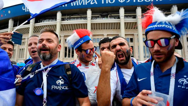France's fans cheer as they arrive prior to the Russia 2018 World Cup final football match between France and Croatia at the Luzhniki Stadium in Moscow on July 15, 2018. / AFP PHOTO / Alexander NEMENOV / RESTRICTED TO EDITORIAL USE - NO MOBILE PUSH ALERTS/DOWNLOADS ALEXANDER NEMENOV/AFP/Getty Images