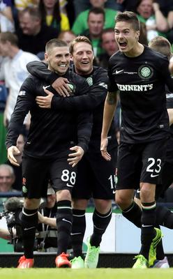 Celtic's Gary Hooper(left) celebrates his second goal with Kris Commons and Mikael Lustig during the William Hill Scottish Cup Final at Hampden Park, Glasgow. PRESS ASSOCIATION Photo. Picture date: Sunday May 26, 2013. See PA story SOCCER Scottish Cup. Photo credit should read: Danny Lawson/PA Wire. EDITORIAL USE ONLY.