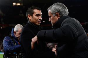 Manchester United's Portuguese manager Jose Mourinho (R) greets Feyenoord's Dutch manager Giovanni van Bronckhorst (L) ahead of the UEFA Europa League group A football match between Manchester United and Feyenoord at Old Trafford stadium in Manchester, north-west England, on November 24, 2016. / AFP PHOTO / Oli SCARFFOLI SCARFF/AFP/Getty Images
