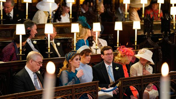 (L-R) The Duke of York, Princess Beatrice, Princess Eugenie and Jack Brooksbank sit ahead of the wedding ceremony of Britain's Prince Harry, Duke of Sussex and US actress Meghan Markle in St George's Chapel, Windsor Castle, in Windsor, on May 19, 2018. / AFP PHOTO / POOL / Jonathan BradyJONATHAN BRADY/AFP/Getty Images