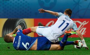 Iceland's defender Ragnar Sigurdsson (L) and England's forward Jamie Vardy vie for the ball during Euro 2016 round of 16 football match between England and Iceland at the Allianz Riviera stadium in Nice on June 27, 2016. / AFP PHOTO / ANNE-CHRISTINE POUJOULATANNE-CHRISTINE POUJOULAT/AFP/Getty Images
