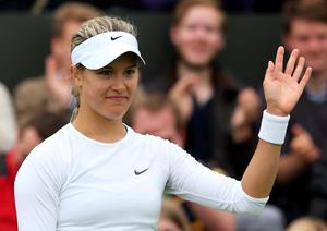 LONDON, ENGLAND - JUNE 24:  Eugenie Bouchard of Canada celebrates match point during her Ladies' Singles first round match against Galina Voskoboeva of Kazakhstan on day one of the Wimbledon Lawn Tennis Championships at the All England Lawn Tennis and Croquet Club on June 24, 2013 in London, England.  (Photo by Julian Finney/Getty Images)