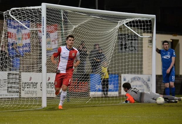 Linfield's Jimmy Callacher scores during this evenings game at Stangmore Park. Credit: Colm Lenaghan/Pacemaker Press