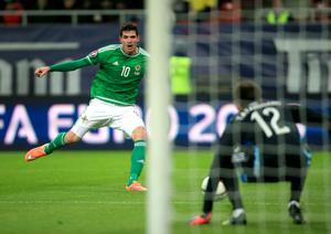 Northern Ireland's Kyle Lafferty has a shot on target during the UEFA Euro 2016 qualifier at the Arena Nationala, Bucharest. Nick Potts/PA Wire.