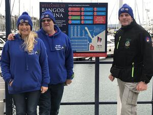 Sea swimmers Marie-Theresa Davis Hanson and her husband Stephen Hanson welcome Henry O'Donnell to Bangor on his quest to swim around Ireland. (Rebecca Black/PA)
