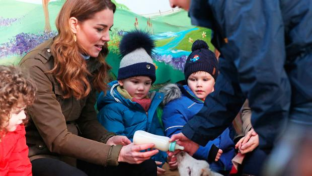 The Duchess of Cambridge helps children feed a lamb during a visit to The Ark Open Farm, at Newtownards, near Belfast, where she is meeting with parents and grandparents to discuss their experiences of raising young children for her Early Childhood survey. PA Photo. Picture date: Wednesday February 12, 2020. See PA story ROYAL Kate. Photo credit should read: Liam McBurney/PA Wire