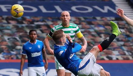 Blue blood: Steven Davis puts Rangers ahead in the recent Old Firm Cup tie