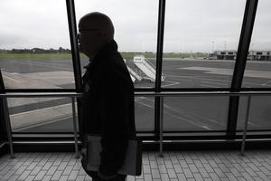 Pacemaker Press 4/10/2016 Significant disruption for passengers  at Belfast International Airport  on Tuesday after a freight plane got stuck on the runway. The airport said the runway would open for arrivals from 09:00 BST but there would be knock-on delays. Earlier, all flights were suspended. A short time ago, the airport said some flights were starting to take off but inbound flights so far, have been cancelled. A freight air coming in to land just before 6am had a number of burst tyres and had to stop right in the junction of both runways. Pic Colm Lenaghan/Pacemaker