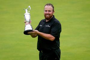 Memorable time: Shane Lowry celebrates with the Claret Jug at Portrush