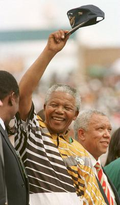 (FILE PHOTO) Former South African President Nelson Mandela Has Died Aged 95 31 Jan 1996:  South Africa president Nelson Mandela salutes the crowd before the opening game of the African Cup of Nations in Johanassberg, South Africa. Mandatory Credit: Gary M. Prior/ALLSPORT