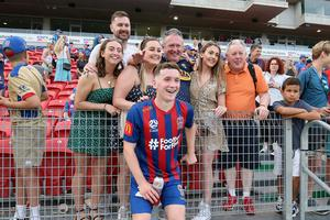 Bobby Burns is enjoying a run of starts for Newcastle Jets and recently had some home support, including from his dad Thomas (orange t-shirt).