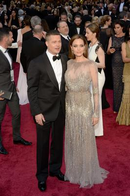 HOLLYWOOD, CA - MARCH 02:  Actors Brad Pitt (L) and Angelina Jolie attend the Oscars held at Hollywood & Highland Center on March 2, 2014 in Hollywood, California.  (Photo by Kevork Djansezian/Getty Images)