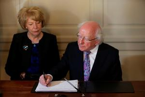 President Michael D Higgins and his wife Sabina sign a book of condolence at Mansion House in Dublin for those killed in the Berkeley balcony collapse. Photo: Niall Carson/PA