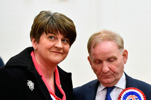 Democratic Unionist party leader and former First Minister Arlene Foster consoles Lord Morrow who lost his seat in the Northern Ireland Stormont election count. (Photo by Charles McQuillan/Getty Images)