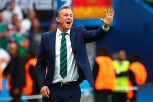 PARIS, FRANCE - JUNE 21: Michael O'Neill manager of Northern Ireland gestures during the UEFA EURO 2016 Group C match between Northern Ireland and Germany at Parc des Princes on June 21, 2016 in Paris, France. (Photo by Alexander Hassenstein/Getty Images)