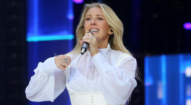 Ellie Goulding came to the rescue of a driver being pushed sideways by a Royal Mail van (Isabel Infantes/PA)