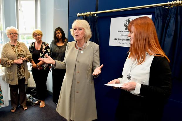 BELFAST, NORTHERN IRELAND - MAY 21:  Camilla, Duchess of Cornwall visits Ballyhackamore Credit Union on May 21, 2015 in Belfast, Northern Ireland. Prince Charles, Prince of Wales and Camilla, Duchess of Cornwall will attend a series of engagements in Northern Ireland following their two day visit in the Republic of Ireland.  (Photo by Jeff J Mitchell - WPA Pool/Getty Images)