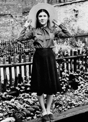 FILE - This May 2, 1973 file photo shows Carrie Fisher, the 16-year-old daughter of Debbie Reynolds and Eddie Fisher, in the back garden of the house on the East Side of New York where she lives with her mother. On Tuesday, Dec. 27, 2016, a publicist says Fisher has died at the age of 60. (AP Photo/Jerry Mosey, File)
