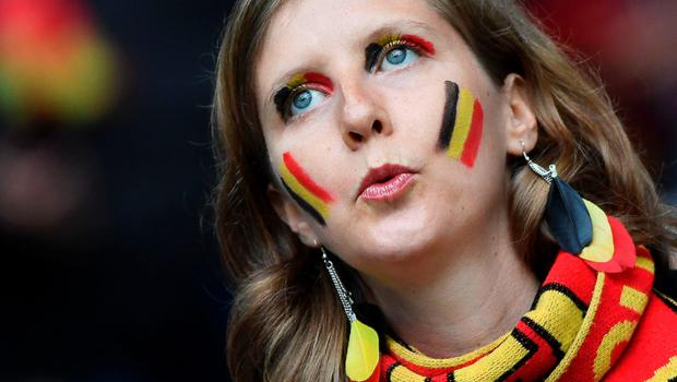 A Belgium supporter waits for the start of the Euro 2016 quarter-final football match between Wales and Belgium at the Pierre-Mauroy stadium in Villeneuve-d'Ascq near Lille, on July 1, 2016. / AFP PHOTO / MIGUEL MEDINAMIGUEL MEDINA/AFP/Getty Images