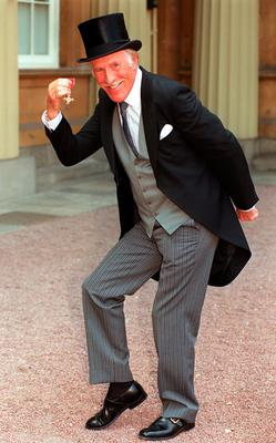 Sir Bruce Forsyth with his OBE. John Stillwell/PA Wire
