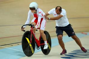 RIO DE JANEIRO, BRAZIL - AUGUST 16: Daria Pikulik of Poland is given a start by a coach during the Women's Omnium Flying Lap race on Day 11 of the Rio 2016 Olympic Games at the Rio Olympic Velodrome on August 16, 2016 in Rio de Janeiro, Brazil.  (Photo by Bryn Lennon/Getty Images)