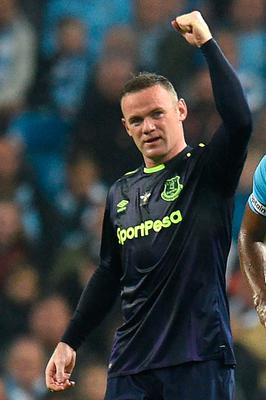 Everton's English striker Wayne Rooney celebrates scoring his team's first goal during the English Premier League football match between Manchester City and Everton at the Etihad Stadium in Manchester, north west England, on August 21, 2017.  / AFP PHOTO / Oli SCARFF / RESTRICTED TO EDITORIAL USE. No use with unauthorized audio, video, data, fixture lists, club/league logos or 'live' services. Online in-match use limited to 75 images, no video emulation. No use in betting, games or single club/league/player publications.  / OLI SCARFF/AFP/Getty Images