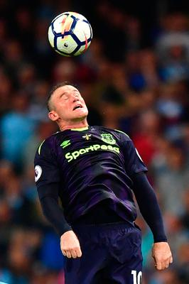 Everton's English striker Wayne Rooney heads the ball during the English Premier League football match between Manchester City and Everton at the Etihad Stadium in Manchester, north west England, on August 21, 2017. / AFP PHOTO / Anthony DEVLIN / RESTRICTED TO EDITORIAL USE. No use with unauthorized audio, video, data, fixture lists, club/league logos or 'live' services. Online in-match use limited to 75 images, no video emulation. No use in betting, games or single club/league/player publications.  / ANTHONY DEVLIN/AFP/Getty Images