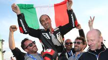 Riding high: The first ever Italian winner Stefano Bonetti celebrates winning the Supertwins race