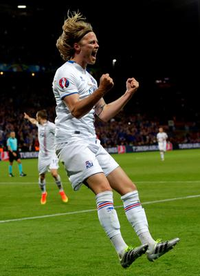 Iceland's Birkir Bjarnason celebrates after scoring his sides first goal during the Euro 2016 Group F soccer match between Portugal and Iceland at the Geoffroy Guichard stadium in Saint-Etienne, France, Tuesday, June 14, 2016. (AP Photo/Pavel Golovkin)