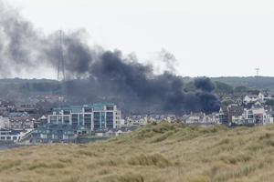 Smoke blows over Portstewart from a house fire. Credit: Michael Cooper