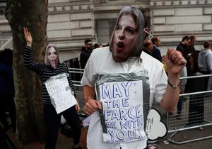 LONDON, ENGLAND - JULY 13:  A protestor wearing a Theresa May mask takes part in small demonstration outside Downing Street on July 13, 2016 in London, England. Former Home Secretary Theresa May becomes the UK's second female Prime Minister after she was selected unopposed by Conservative MPs to be their new party leader. She is currently MP for Maidenhead.  (Photo by Carl Court/Getty Images)