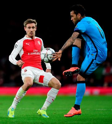 Barcelona's Brazilian defender Dani Alves (R) vies with Arsenal's Spanish defender Nacho Monreal during the UEFA Champions League round of 16 1st leg football match between Arsenal and Barcelona at the Emirates Stadium in London on February 23, 2016.   Arsenal's Spanish defender Nacho Monreal  / AFP / JAVIER SORIANOJAVIER SORIANO/AFP/Getty Images