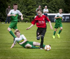 Bobby Bradley, Foyle Harps centre back gets in a telling challenge on Arklow's Kyle Nolan to prevent him getting a shot on goal, during the Hughes Insurance Foyle Cup clash at Lisnagelvin on Thursday afternoon. FC. FC04-M1-11