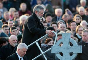 Gerry Adams steps up to speak at Derry City Cemetery, in Londonderry, after the funeral service of Northern Ireland's former deputy first minister and ex-IRA commander Martin McGuinness. PRESS ASSOCIATION Photo. Picture date: Thursday March 23, 2017. See PA story FUNERAL McGuinness. Photo credit should read: Brian Lawless/PA Wire