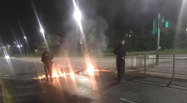 Road barriers were set alight during disturbances in Londonderry at the weekend. Credit: Sandra Duffy