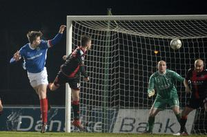 Presseye.com 7th February 2017 Toals County Antrim Shield final between Crusaders and Linfield at the Showgrounds in Ballymena.  Linfields Cameron Stewart heads the Blues into a 1-0 lead Photograph by Presseye/Stephen Hamilton