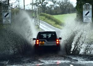 Pacemaker Press 4/12/2015   Motorists struggle threw floods in Glenavy, Co Antrim. Warnings for heavy rain and strong winds have been issued as Storm Desmond is to hit  across Northern Ireland and the Republic this weekend. Pic Colm Lenaghan/ Pacemaker