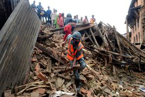 "Nepalese rescue personnel and volunteers observe damaged buildings in Bhaktapur, on the outskirts of Kathmandu, on April 27, 2015, two days after a 7.8 magnitude earthquake hit Nepal. Nepalis started fleeing their devastated capital on April 27 after an earthquake killed more than 3,800 people and toppled entire streets, as the United Nations prepared a ""massive"" aid operation.  AFP PHOTO / PRAKASH MATHEMAPRAKASH MATHEMA/AFP/Getty Images"