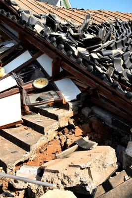 MASHIKI, JAPAN - APRIL 15:  A clock stopped at 0:05 is seen in the collapsed house a day after the 2016 Kumamoto Earthquake on April 15, 2016 in Mashiki, Kumamoto, Japan. The owner of the house said that the house was damaged more by the aftershock that happened at 0:05. As of April 15 morning, at least nine people died in the powerful earthquake with a preliminary magnitude of 6.4 that struck Kumamoto Prefecture on April 14, 2016.  (Photo by Masterpress/Getty Images)