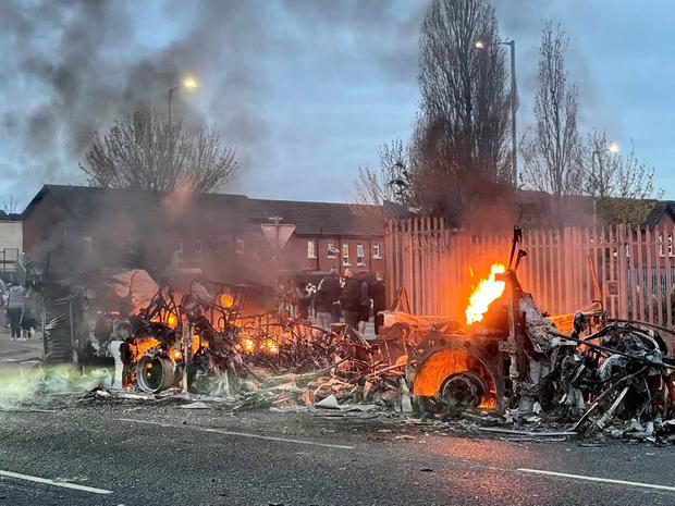 The wreckage of a Translink Metrobus on fire on the Shankill Road in Belfast during further unrest. Picture date: Wednesday April 7, 2021. Photo credit: Liam McBurney/PA Wire