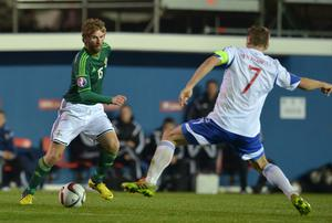BELFAST, NORTHERN IRELAND - OCTOBER 11:  Paddy McCourt (L) of Northern Ireland competes Frodi Benjaminsen of Faroe Islands (R) during the Euro 2016 Qualifier between Northern Ireland and Faroe Islands at Windsor Park on October 11, 2014 in Belfast, Northern Ireland.  (Photo by Charles McQuillan/Getty Images)