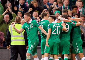 Republic of Ireland's players celebrate their first goal during the Euro 2016 qualifying group D football match between Republic of Ireland and Georgia at Aviva Stadium in Dublin on September 7, 2015. AFP PHOTO / PAUL FAITHPAUL FAITH/AFP/Getty Images