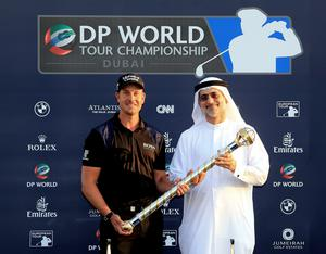 Henrik Stenson from Sweden, left, with Mohammed Sharaf holds the trophy of the DP World Golf Championship as he poses for a picture after the final round of DP World Golf Championship, in Dubai, United Arab Emirates.(AP Photo)