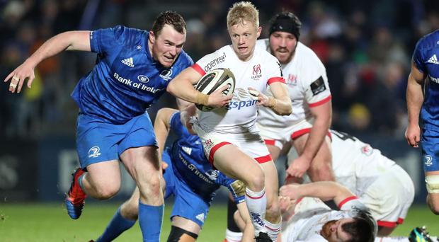 Ulster scrum-half Dave Shanahan eludes the grasp of Leinster loosehead prop Peter Dooley in their clash at the RDS Arena (INPHO/Billy Stickland)