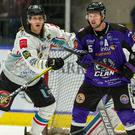 Belfast Giants defenceman Kevin Raine (left) clashes with Glasgow Clan forward Chad Rau